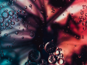 An abstract photo of pills and liquid in a vortex