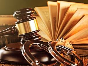 Gavel, handcuffs, and law books