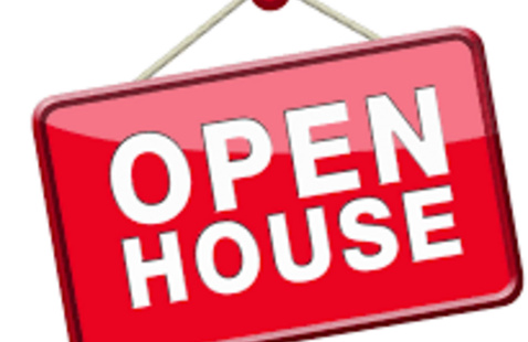 Sign reading: Open House