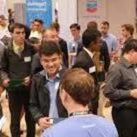 Candidates speaking with recruiters at a career fair