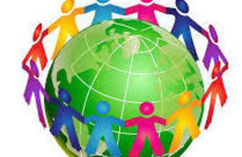 People joining hands encircling the globe