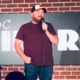 A veteran performs stand-up comedy.