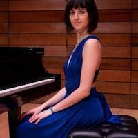 Masters in Music student Letizia Pent sitting at piano