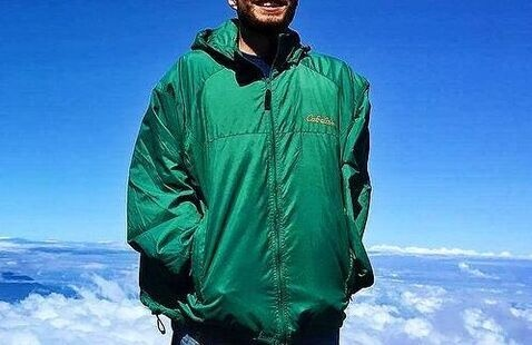 Nico Angerosa, standing on top of a mountain in Costa Rico during his service year