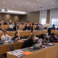 students sitting in a lecture hall.