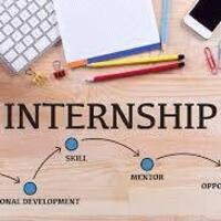 Laptop, paper and pencils with words: Internship: Professional Development, Skill, Mentor, Opportunity