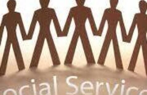 People joining hands with the words Social Services