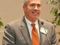 Dr. Jeffrey Allen standing at podium