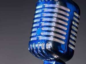 photo of blue microphone