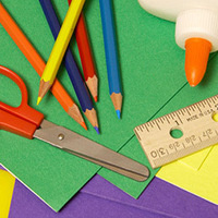 craft paper, colored pencils, scissors, and other craft supplies