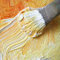 image of gold paint and gold paint on a paintbrush