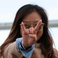 Student throwing horns up abroad