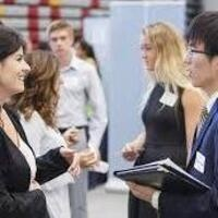 A job candidate talking with a recruiter at a career fair
