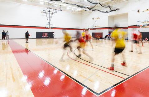 Students playing basketball in Moretz Intramural Gym