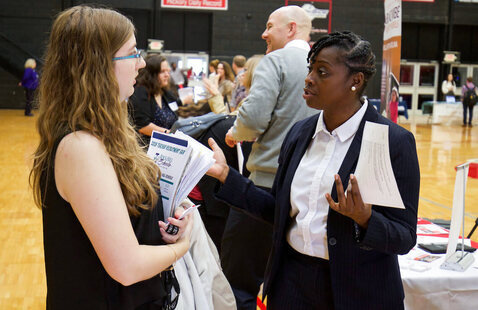 Student talks with employer at career fair