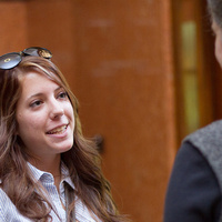 female student talks to woman, networking