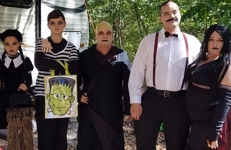 Campers dressed as the Adams Family