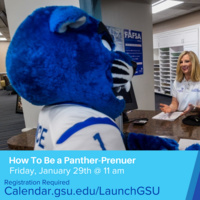 Georgia State mascot of panther sitting in front of woman smiling