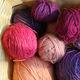 balls of yarn in a wicker basket