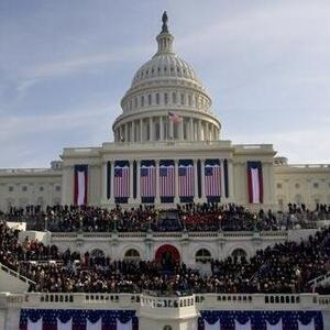 Photo of US Capital adorned with flags and red, white, and blue banners for Inauguration Day 2009