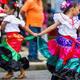 Children performing a cultural dance.