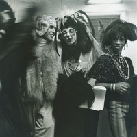 "Leonard Freed. Three costumed and face painted audience members at a performance of the ""Cockettes.""1971. Gelatin silver print. LUF 2016 1390. Gift of George Stephanopoulos"