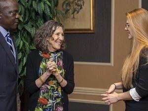 Risa Zwerling Wrighton congratulations two scholarship recipeints