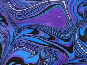 photo of marbled paper in blue, purple, and black