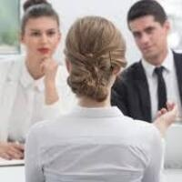 A candidate and two employers in an interview.