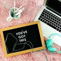 "laptop, pencils, headphones, chalk board that says ""You've got this"""
