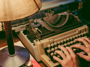 photo of hands on typewriter