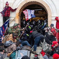 Image of violent insurrectionists breaking into the Capitol