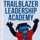 Trailblazer Leadership Academy. At the bottom of the text is a picture of Toro with his hands raised in excitement.
