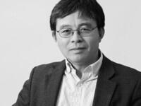 Prof. Xiaoyang Zhu seated facing forward, black and white