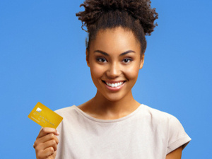 student holding a credit card