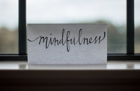 """Note in window with """"mindfulness"""" written on it"""