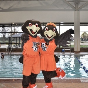 Freddie and Frieda Falcon beside pool at Student Recreation Center
