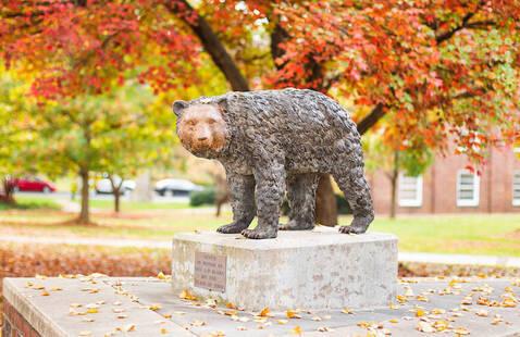 Bear cub sculpture in fall