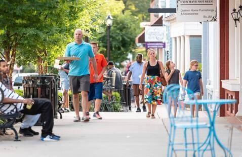 people walking outside shops