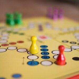 board game with yellow and red game pieces