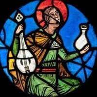 Medieval stained glass of an Apocalyptic Elder holding a lute and a flask