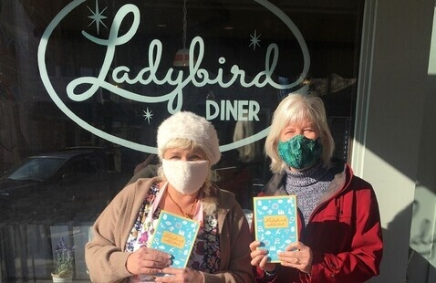 Author and Diner Owner Meg Heriford and KPR Presents host Kaye McIntyre in front of Ladybird Diner