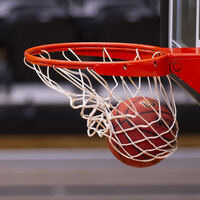 Basketball swishing into a basket