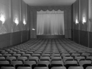 Stage and seats in theater, photograph by Paul S. Henderson (1899-1988), August 1953. Maryland Center for History and Culture, H. Furlong Baldwin Library, Baltimore City Life Museum Collection, Paul S. Henderson Collection, HEN.00.B1-021