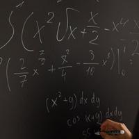 calculus equation on chalkboard