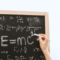 chalkboard with physics equation written on it