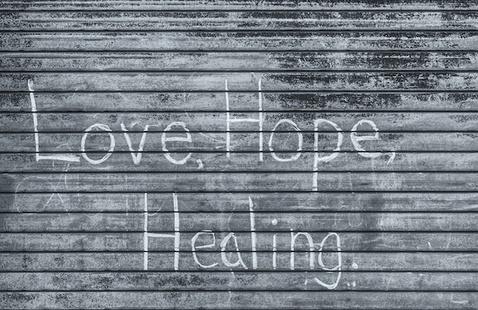 Black & white: Love, Hope, Healing graffiti on a garage door