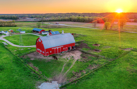 View of barn and horses at The Farm at Prophetstown, photo by Frank Oliver