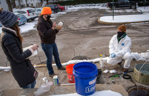 Civil engineering majors (left to right) Jordyn Koerper, Maya Staton and Johnny Murray collect wastewater samples for COVID-19 monitoring.