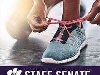 Staff Senate logo - person tying shoes for a walk/run